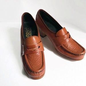 1bd811e1549 Vintage leather penny loafer with a stacked heel.